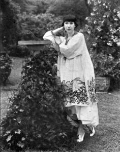 Florine Stettheimer, American artist, in her Bryant Park garden.